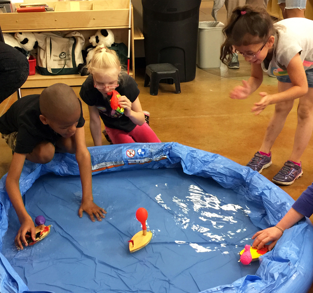 Nevada Blind Children's Foundation students Christian Lowe, Kristlynn Allison and Oschen Cabrera experiment with boats by painting their own wooden boats and powering it with a balloon during Sp ...