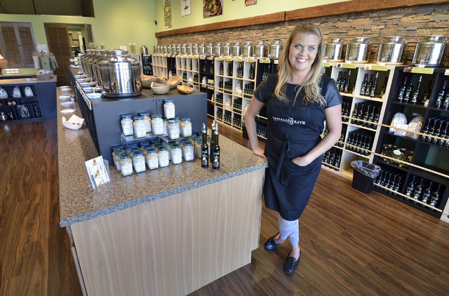 Sarah Snajczuk, manager at Totally Olive, is shown in the store at 10271 S. Eastern Ave. in Henderson on Friday, April 3, 2015. (Bill Hughes/Las Vegas Review-Journal)