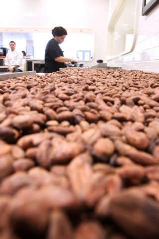 A woman packages finished chocolate next to a table for sorting cocoa beans at Hexx at Paris Las Vegas Friday, April 3, 2014. (Sam Morris/Las Vegas Review-Journal) Follow Sam Morris on Twitter @sa ...