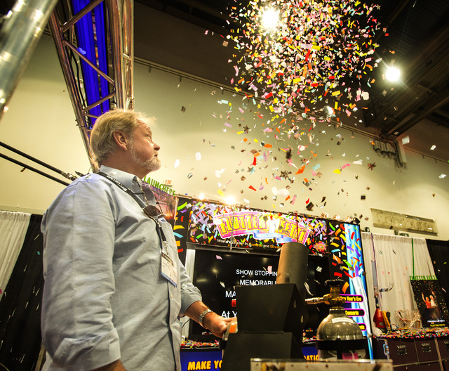 Jon Stern demonstrates a confetti cannon at  the Flutter Felli booth during the Nightclub and Bar Show at the Las Vegas Convention Center, Las Vegas Convention Center 3150 Paradise Road, on Tuesda ...