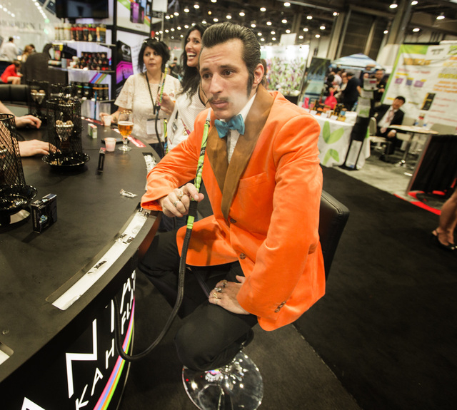 Adam Cardone smokes at the Fantasia Hookah booth during the Nightclub and Bar Show at the Las Vegas Convention Center, Las Vegas Convention Center 3150 Paradise Road, on Tuesday, March 31, 2015. ( ...