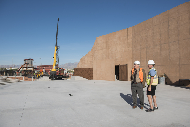 Director of Neighborhood and Leisure Services Cass Palmer, left, stands with Brett Miller at the site of the new amphitheater under construction at Craig Ranch Regional Park in North Las Vegas on  ...