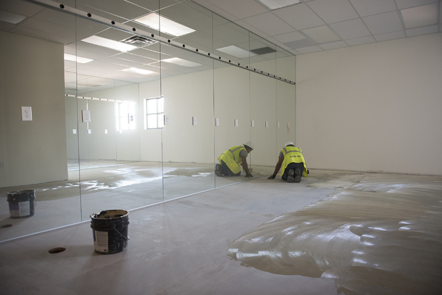 A worker prepares a floor as construction continues near the new amphitheater at Craig Ranch Regional Park in North Las Vegas on Wednesday, April 29, 2015. October 2015 is the estimated grand open ...