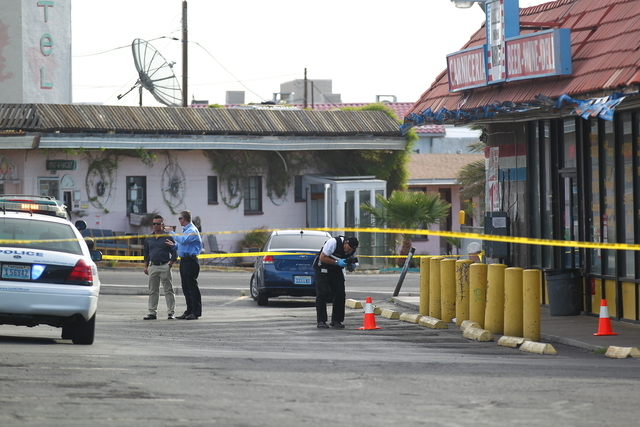 North Las Vegas police investigate a shooting in the 2500 block of Las Vegas Boulevard North that left one man in critical condition Tuesday morning, April 14, 2015. One person has been arrested.  ...