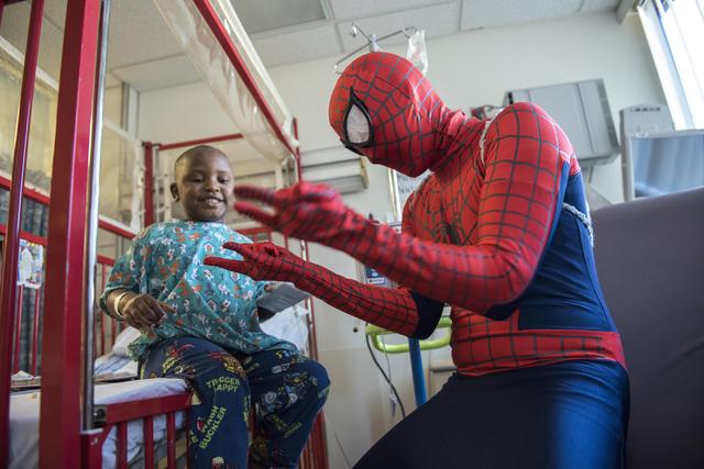 Volunteer Michael Mutzhaus, dressed as Spiderman, plays with Josiah Bradley, 4, at UMC Childrens Hospital in Las Vegas on Saturday, Feb. 21, 2015. Volunteers from the non-profit organization Criti ...