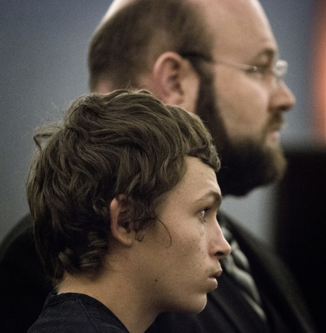 Erich Nowsch, left, stands beside his attorney Augustus Claus during his appearance in Regional Justice Center, 200 Lewis Avenue., on March 26 2015 The  19-year-old plead not guilty in  with in th ...