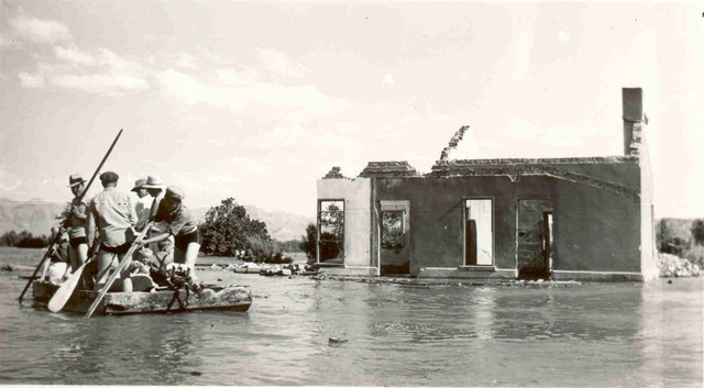 A group of people raft past the remains of the U.S. Post Office in St. Thomas, Nevada, as raising water levels of the Lake Mead reservoir behind Hoover Dam begins to flood the old Mormon settlemen ...