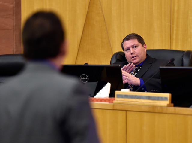 Las Vegas police detective Matt Gillis, right, answers questions from attorney Mace Yampolsky during the public fact-finding review of the officer involved shooting of Ronald Tate at the Clark Cou ...