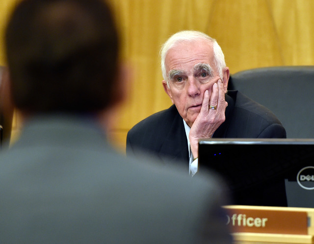 Hearing master William Jansen, right, listens to attorney Mace Yampolsky during the public fact-finding review of the officer involved shooting of Ronald Tate at the Clark County Government Center ...
