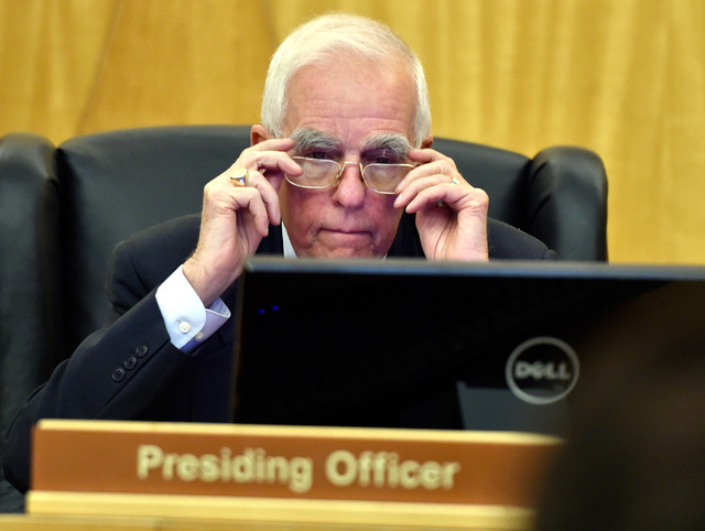 Hearing master William Jansen review his monitor during the public fact-finding review of the officer involved shooting of Ronald Tate at the Clark County Government Center on Friday, April 17, 20 ...