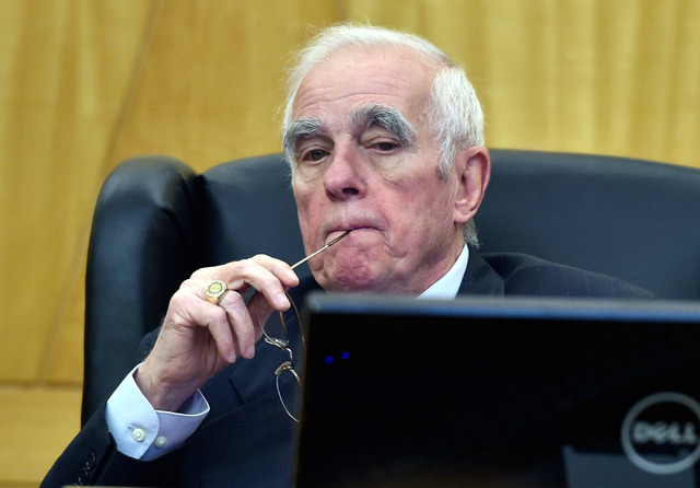 Hearing master William Jansen listens during the public fact-finding review of the officer involved shooting of Ronald Tate at the Clark County Government Center on Friday, April 17, 2015, in Las  ...