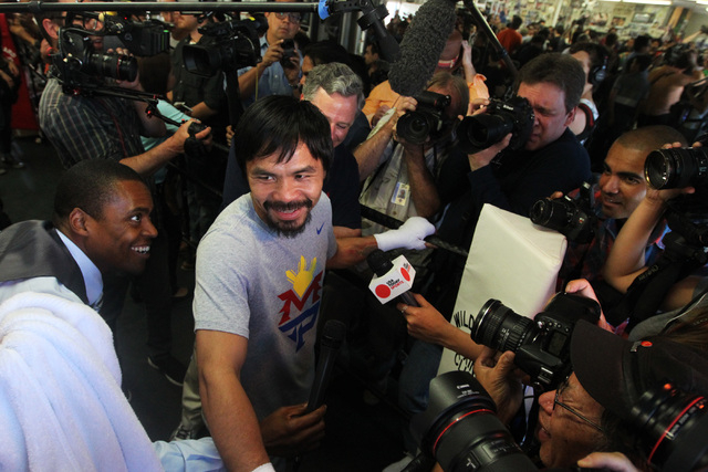 Manny Pacquiao is interviewed during his media workout Wednesday, April 15, 2015, at Freddy Roach's Wild Card Gym in Los Angeles. Pacquiao faces Floyd Mayweather in a welterweight unification bout ...