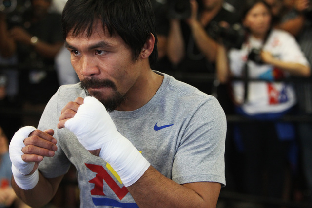 Manny Pacquiao shadow boxes during his media workout Wednesday, April 15, 2015, at Freddy Roach's Wild Card Gym in Los Angeles. Pacquiao faces Floyd Mayweather in a welterweight unification bout o ...