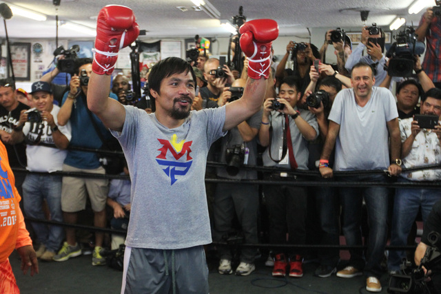 Manny Pacquiao thanks members of the media during his media workout Wednesday, April 15, 2015, at Freddy Roach's Wild Card Gym in Los Angeles. Pacquiao faces Floyd Mayweather in a welterweight uni ...