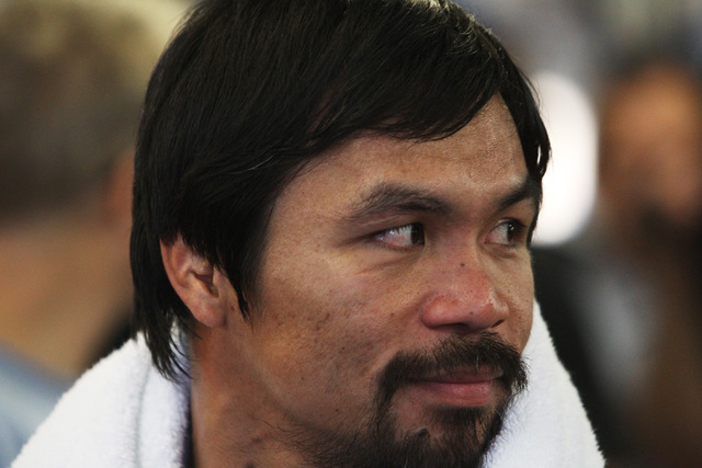 Manny Pacquiao looks over his shoulder during his media workout Wednesday, April 15, 2015, at Freddy Roach's Wild Card Gym in Los Angeles. Pacquiao faces Floyd Mayweather in a welterweight unifica ...