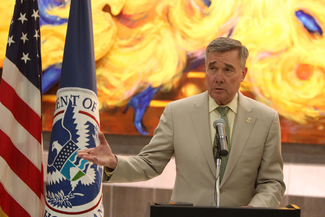 Gil Kerlikowske, left, commissioner for U.S. Customs and Border Protection, speaks during a press conference on the newly installed Automated Passport Control kiosks at the U.S. Customs Arrivals H ...