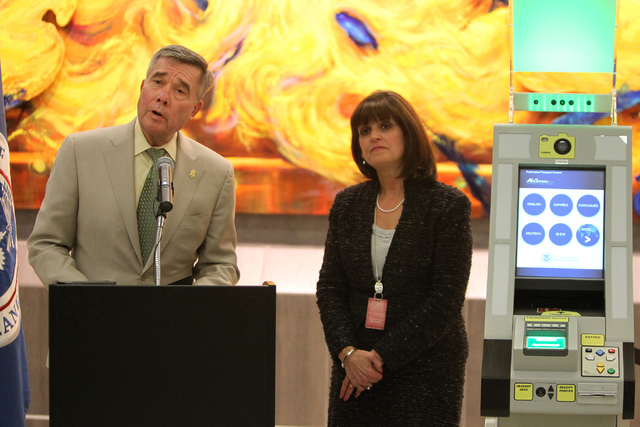 Gil Kerlikowske, left, commissioner for U.S. Customs and Border Protection, with Rosemary Vassiliadis, director for the Clark County Department of Aviation, speaks during a press conference on the ...