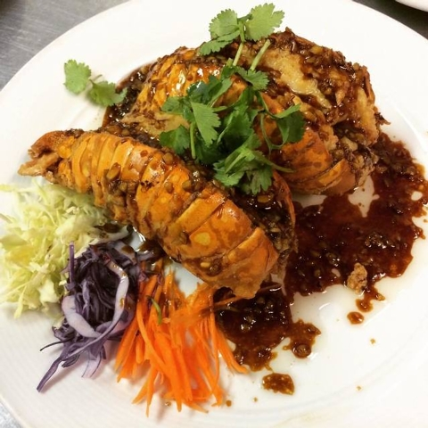 Garlic lobster, deep-fried lobster tails topped with garlic-black pepper sauce, is shown at Ping Pong Thai, 2955 E. Sunset Road, No. 109. (Courtesy Facebook)