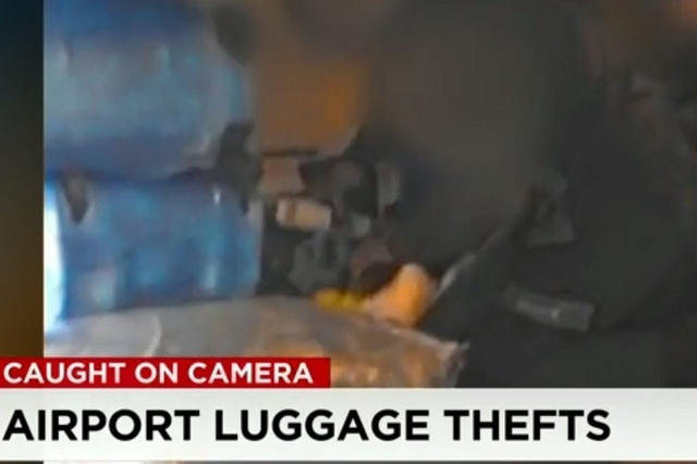 Police set up a hidden camera inside the belly of a plane last year and caught baggage handlers rifling through luggage and stealing various items. (Screengrab, CNN)