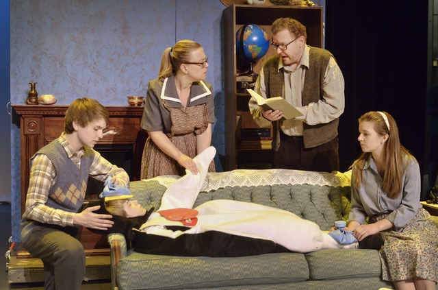 The Popper family, played by, from left, Jake Rouse, Kristin Quinn, Michael Button and Abigayle Kompst (cq), come to the aid of a penguin, played by Zachary Krause, on couch, during a rehearsal fo ...