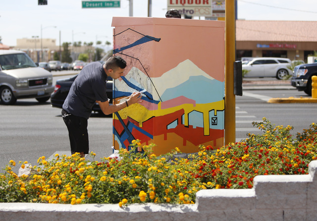 Artist Valentin Yordanov covers up graffiti on a utility box at the corner of Desert Inn Road and Maryland Parkway on Thursday, April 30, 2015. The box and others on Maryland Parkway were painted  ...