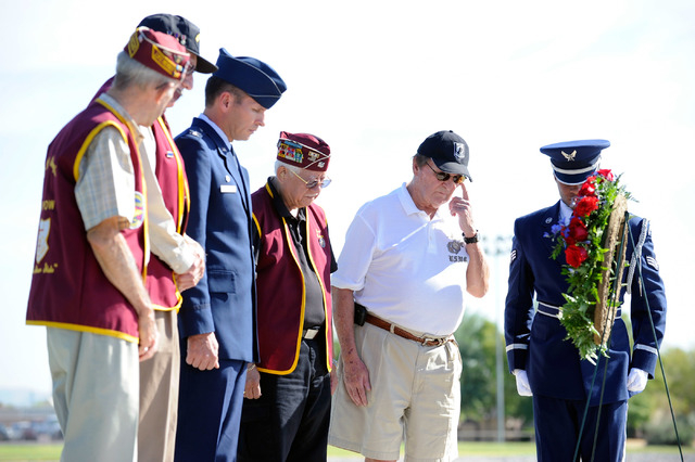 Former POW Joe North, second from the right, appears to wipe a tear during the wreath-laying ceremony of the national POW/MIA Recognition Day at Nellis Air Force Base on Friday, Sept. 21, 2012.  A ...