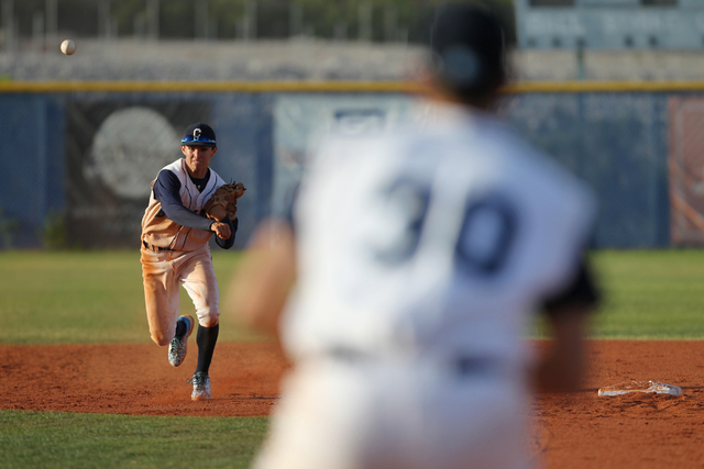 Centennial's Tanner Wright (11) throws to first base for an out against Chatsworth in their baseball game at Centennial High School in Las Vegas Wednesday, April 1, 2015. Centennial won 11-5. (Eri ...