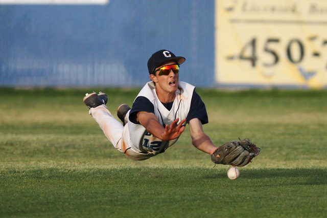 Centennial's Gino Sabey (12) is short of a catch against Chatsworth in their baseball game at Centennial High School in Las Vegas Wednesday, April 1, 2015. Centennial won 11-5. (Erik Verduzco/Las  ...