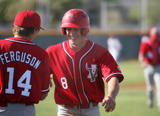Arbor View's Sam Pastrone, right, celebrates with teammate Cody Ferguson at the end of the third inning during a baseball game against Cimarron-Memorial at Cimarron-Memorial High School Tuesday, A ...