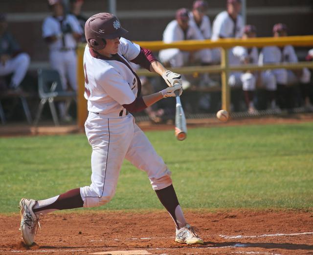 Cimarron-Memorial's Trevor Lippard hits the ball during a baseball game against Arbor View at Cimarron-Memorial High School Tuesday, April 14, 2015, in Las Vegas. (Ronda Churchill/Las Vegas Review ...
