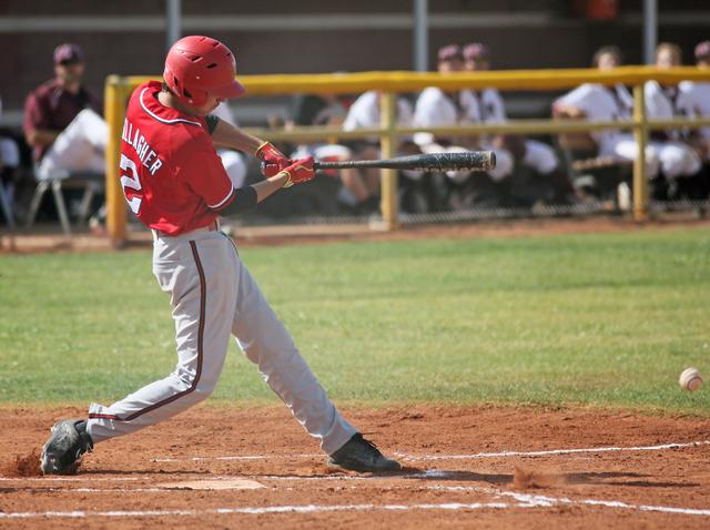 Arbor View's Quinn Gallagher hits the ball during a baseball game against Cimarron-Memorial at Cimarron-Memorial High School Tuesday, April 14, 2015, in Las Vegas. (Ronda Churchill/Las Vegas Revie ...