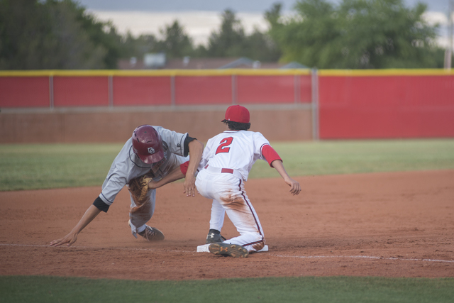 Arbor View's Quinn Gallagher (2) tags out Desert Oasis Nolan Kingham (22) during their baseball game at Arbor View High School in Las Vegas on Wednesday, April 22, 2015. (Martin S. Fuentes/Las Veg ...