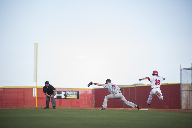 Desert Oasis Chase Adams (8) catches an out at first against Arbor View's R. J. Rodriguez (18) during their baseball game at Arbor View High School in Las Vegas on Wednesday, April 22, 2015. (Mart ...