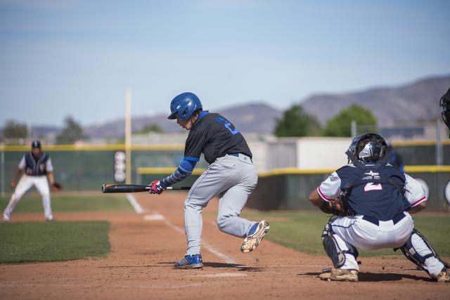Basic's Cory Wills (2) bunts the ball against Coronado during their baseball game at Coronado High School in Henderson on Thursday, April 30, 2015. (Martin S. Fuentes/Las Vegas Review-Journal)