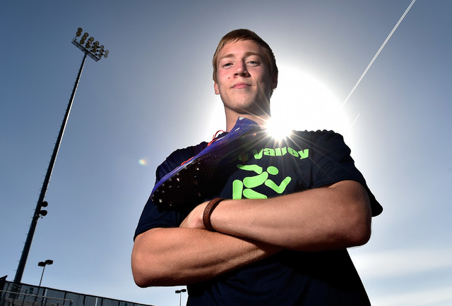 Ian Mack stands with his running spikes over his shoulder trackside at Green Valley High School on Tuesday, April 7, 2015. Mack, a senior at the Henderson school, is ranked in the top five nationa ...