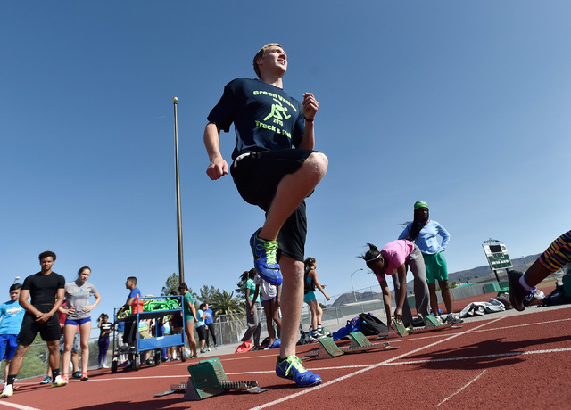 Ian Mack readies himself on the track at Green Valley High School on Tuesday, April 7, 2015. Mack, a senior at the Henderson school, is ranked in the top five nationally in the 100 meter and 200 m ...