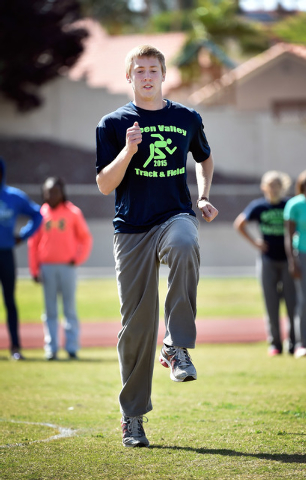 Ian Mack warms up during practice at Green Valley High School on Tuesday, April 7, 2015. Mack, a senior at the Henderson school, is ranked in the top five nationally in the 100 meter and 200 meter ...