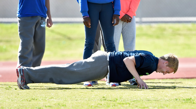 Ian Mack does pushups during practice at Green Valley High School on Tuesday, April 7, 2015. Mack, a senior at the Henderson school, is ranked in the top five nationally in the 100 meter and 200 m ...