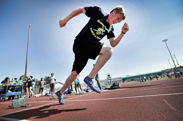 Ian Mack practices with the starting block at the Green Valley High School track on Tuesday, April 7, 2015. Mack, a senior at the Henderson school, is ranked in the top five nationally in the 100  ...