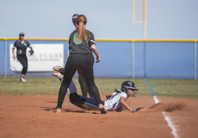 Centennial High School's Angel Love (8) is safe at first base as she attempts to not get caught against Palo Verde High School during their softball game played at Centennial's softball field in L ...