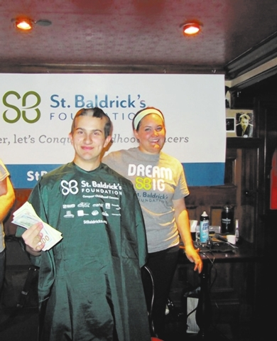 Ri Ra employee Rob Tully collects money to get the rest of his head shaved during the March 7 Ri Ra Las Vegas fundraiser for the St. Baldrick's Foundation. Ri Ra raised more than $11,000 at the  ...