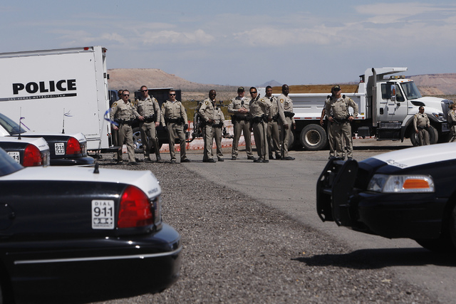 Las Vegas Metro Police try to block access to a BLM impound corral as supporters of rancher Cliven Bundy gather on I-15 just south of Mesquite to demand the release of his cattle on April 12, 2014 ...