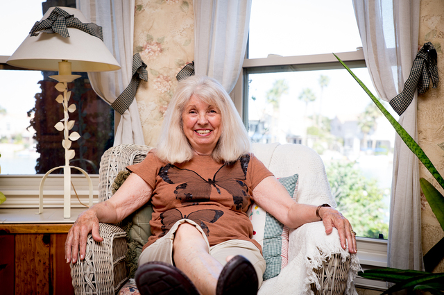 Tonya Harvey/Real Estate Millions  Cindy Coletti, co-owner of Sun West Custom Homes, in her master suite. She built her own dream home on Lake Sahara.