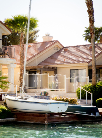 Tonya Harvey/Real Estate Millions  Many homes at The Lakes have electric or sail-powered boats.