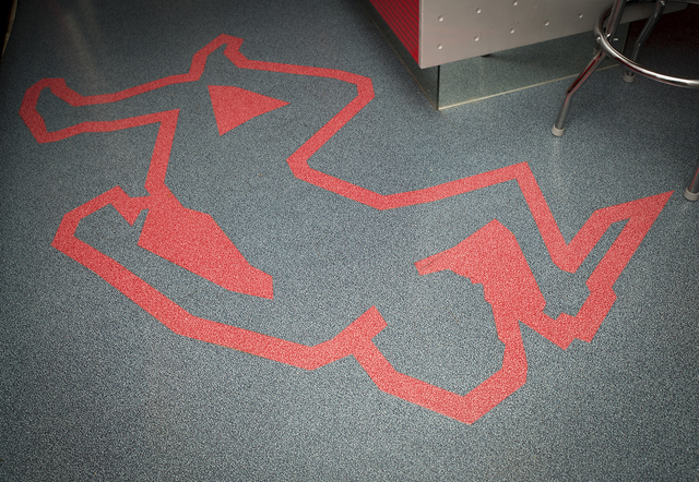 Tonya Harvey/Real Estate Millions  An outline of Jillette's sidekick, Teller, holding a knife is traced on the floor of the black-and-red kitchen area, like that found at a crime scene. (Teller  ...