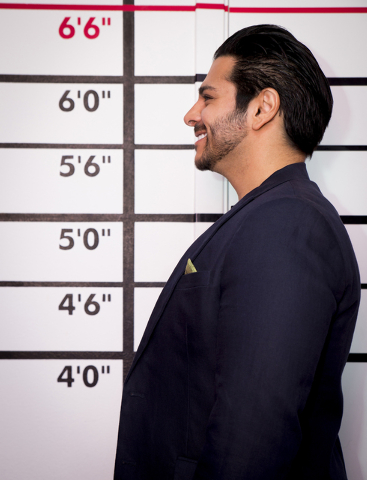 Tonya Harvey/Real Estate Millions  Luxury Realtor and TV correspondent Zar Zanganeh gets his mug shot taken along the wall with horizontal lines pinpointing one's height in the home's entertainm ...