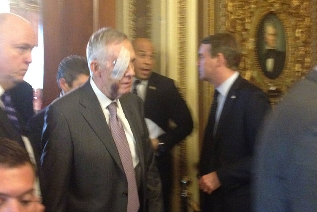 Sen. Harry Reid, D-Nev., center, was back in the U.S. Capitol on Tuesday, Jan. 20, 2015, after being injured in an exercise accident at his Henderson home on New Year's Day. (Steve Tetreault/Ste ...
