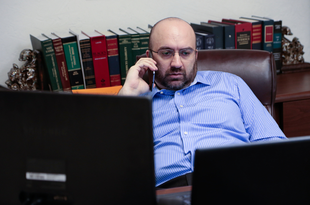 Lawyer Alex Ghibaudo takes a phone call in his office at Schwab Law Group, 2800 W. Sahara Ave., Suite 1H, Las Vegas, Wednesday, Feb. 18, 2015. (Donavon Lockett/Las Vegas Review-Journal)