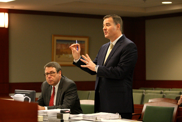 In the courtroom of Judge Susan W. Scann at the Regional Justice Center, Matthew Christian, right, representing the district attorney's office, with Thomas Carroll, argues against the access to  ...