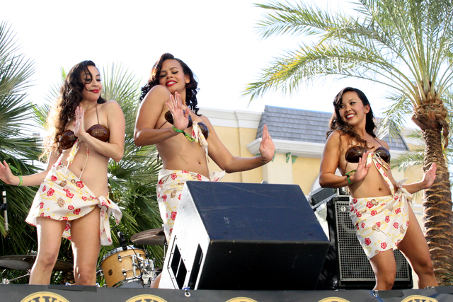 Kehau Gabriel, from left, Ehulani Lucia and Kawailele Noel of Coco Tiki dancers entertain at the Viva Las Vegas Rockabilly Weekend Pool Party at the Orleans hotel-casino on Friday, April 3, 2015.  ...